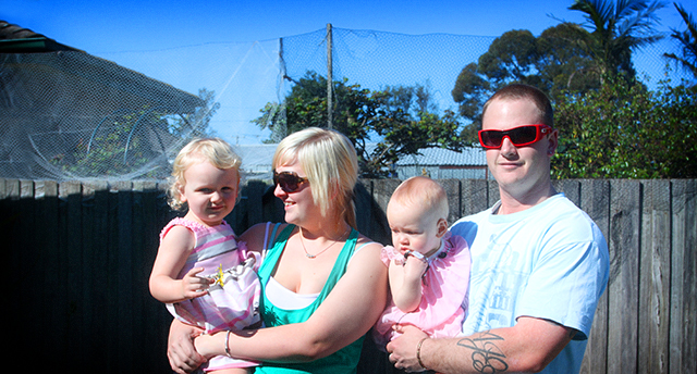 Lisa, partner Wayne and daughters Mia (left) and Zoey