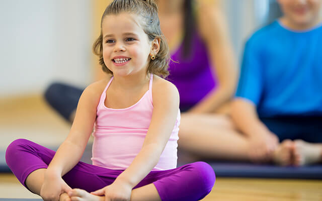Helping kids through yoga
